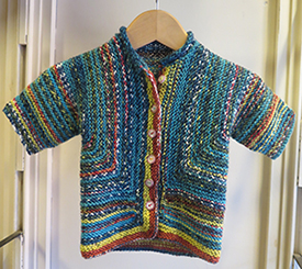 Children's cardigan in sport-weight Schoppel Ambiente merino, space-dyed to create automatic stripes. ($20 to $30).
