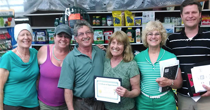 Joan Tifford, second from right, and her son David, center, co-own Fantastic Gardens in Patchogue, Long Island.