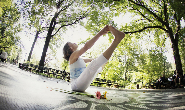 Deborah Caruana of Vital Signs Fitness, Yoga and Coaching, breathes into the boat pose.