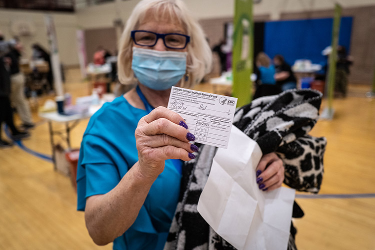 Senior with vaccination record card
